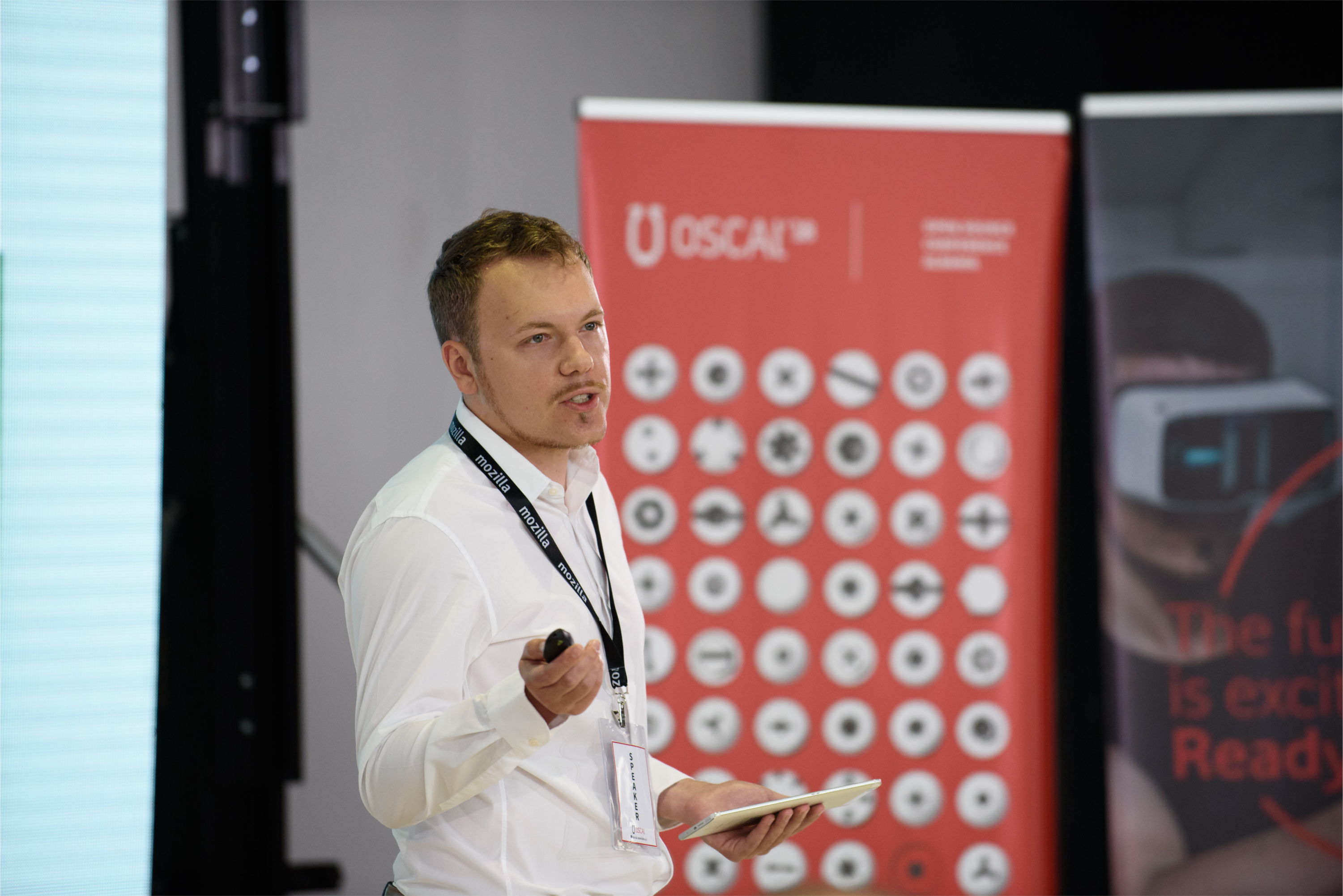 Sam Tuke presenting 'The Economics of Open Source at OSCAl 2018 conference